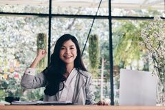 Start up woman raise fist with yes gesture at office. freelance Stock Images