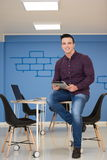 Young startup business man portrait at modern office Stock Photos