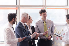 Young startup businessman making presentation to senior investio Stock Images