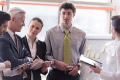 Young startup businessman making presentation to senior investio Stock Photo