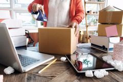 Young startup entrepreneur small business owner working at home, packaging and delivery situation. stock images