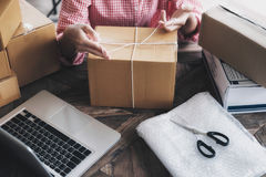 Young startup entrepreneur small business owner working at home, packaging and delivery situation. stock photography