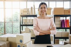 Young startup entrepreneur small business owner working at home. Packaging and delivery situation royalty free stock photo