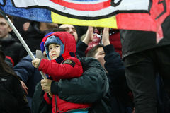 FC Steaua Bucharest- FC Gaz Metan Medias. Young Steua Bucharest supporter waving a flag, during the football match, counting for the Romanian League One Stock Photo