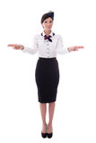 Young stewardess indicating exits isolated on white Royalty Free Stock Images
