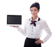 Young stewardess showing laptop with blank screen isolated on wh Stock Images