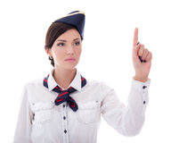 Young stewardess in uniform pointing at something isolated on wh Royalty Free Stock Photo