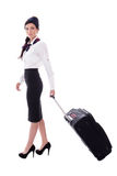 Young stewardess walking with suitcase isolated on white Stock Images