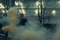 young street artists with smoke bomb royalty free stock image