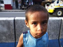 Young street child looking at the camera Stock Photo
