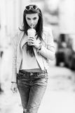 Young street fashion girl on the background of old Royalty Free Stock Photos