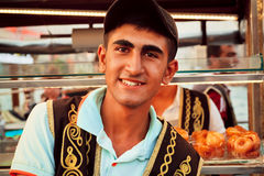 Young street food vendor in the traditional Turkish clothes Stock Photo