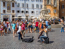 Street musician in Rome. A young street musician playing the violin in front of tourists near the Pantheon Stock Images