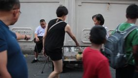 Young street player in Bangkok stock video footage