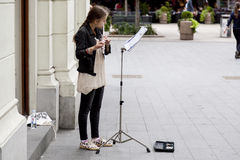 Young street player. Of classical flute music in Croatian capital Zagreb during the summer earns pocket money Stock Image