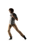 Young street style dancer posing on studio background Stock Photography