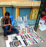 A young street vendor selling colourful ladies items Stock Photos
