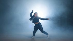 Young street woman doing movements with hips. Hip action. Hip hop culture. Young street woman doing movements with hips. Hip action. Hip hop culture stock footage