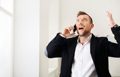Young Stressed Businessman Call Mobile Phone In Modern Office Stock Photo