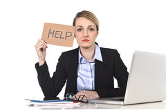 Young stressed businesswoman holding help sign overworked at off Stock Photography