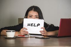 Young stressed and depressed Asian Chinese businesswoman working overwhelmed and exhausted as corporate business employee asking f. Or help desperate and royalty free stock photo