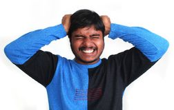 Young stressed indian pulling his hair apart Royalty Free Stock Photography