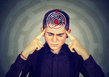 Young stressed man solving puzzle Royalty Free Stock Images