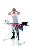 Young stressed Nepalese man, iron, laptop Royalty Free Stock Photography