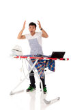Young stressed Nepalese man, iron, laptop Royalty Free Stock Photos