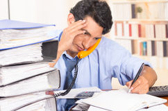 Young stressed overwhelmed man with piles of Stock Photos