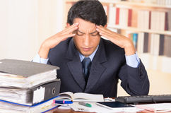 Young stressed overwhelmed man with piles of Stock Images