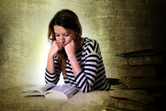 Young stressed student girl studying and preparing MBA test exam Royalty Free Stock Images