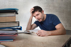 Young stressed student studying on library for exam in stress fe Royalty Free Stock Photography