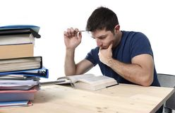 Young stressed student studying on library for exam in stress fe Royalty Free Stock Image
