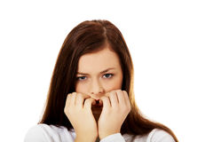 Young stressed woman biting her nails Royalty Free Stock Photo