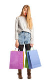 Young stressed woman surrounded by paperbags Stock Photos