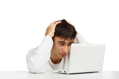 Young stressful man sitting at the netbook Stock Photos