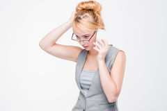 Young stressful woman with mobile phone. Anxiety. Stressful young woman talking on mobile phone. Anxiety, hard problems, tension situation, difficulties Royalty Free Stock Photo