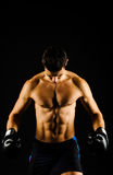 Young strong boxer with black gloves stock photo