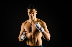 Young strong boxer with hand wraps stock image