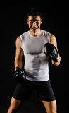 Young strong boxer laughing royalty free stock photos