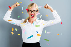Young strong business woman celebrating royalty free stock images