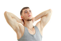 Young strong guy with the session you muscles raised hands behind the neck and looking up isolated on a white background Stock Photography