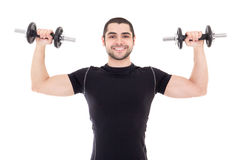 Young strong man in black sportswear doing exercises with dumbbe Royalty Free Stock Photography