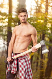 Young strong man in forest Stock Photos