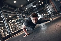 Man fitness. Young strong man during training in the gym stock photos