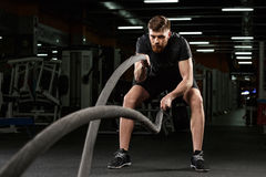 Young strong sports man make sport exercises in gym Royalty Free Stock Photography