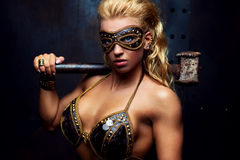 Young strong woman. With hammer royalty free stock photos