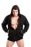 Young stud wearing black hoodie and underwear. Isolated on white studio background Royalty Free Stock Photo