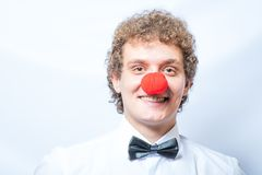 Young studen or Businessman with a red clown nose. Stock Images